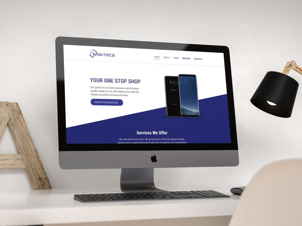 Marnics Repair website design - home page mocked up of imac
